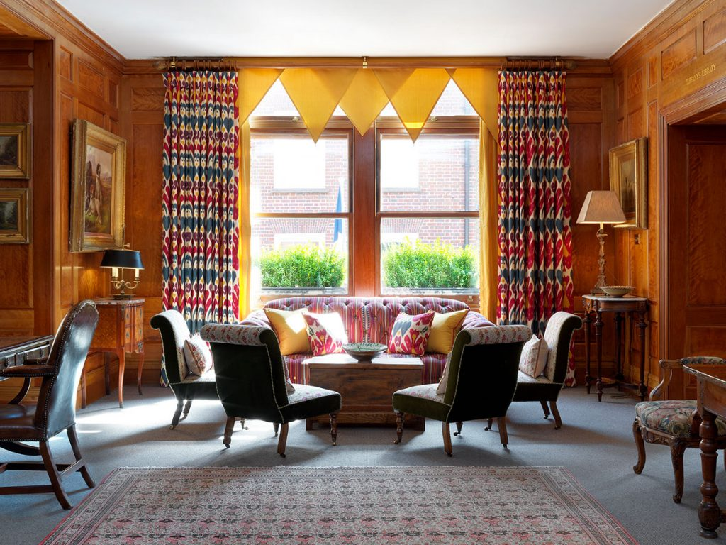 Covent-Garden-Hotel-Drawing-Room designed by Kit Kemp. Window treatment, patterned curtains and yellow pelmet
