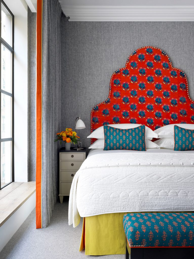 The Whitby Hotel, Firmdale Hotels designed by Kit Kemp bedroom with red headboard and pretty fabric