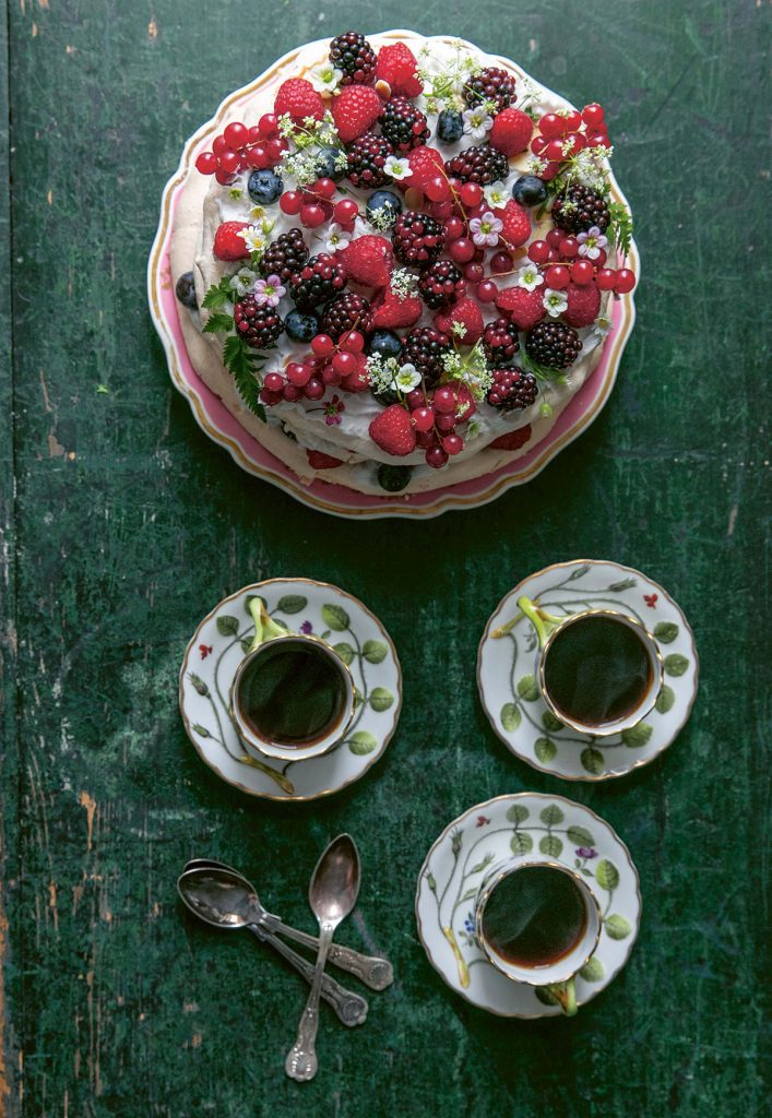 Summer berry cloud cake with three botanical cups and saucers from Skye McAlpine's book, A Table For Friends