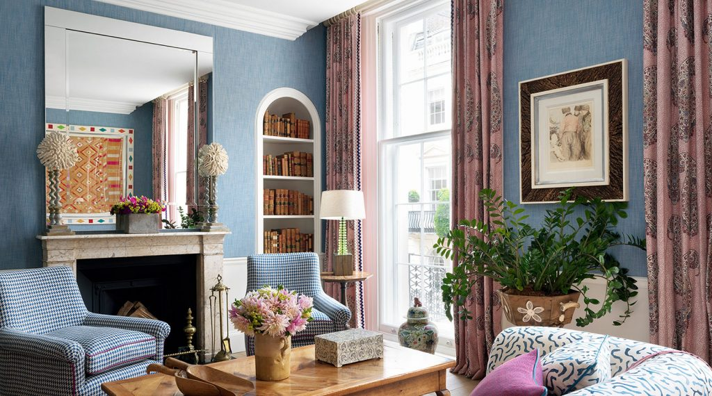 Curtains in Soane Paisley parrot fabric and ric rac trim in blue townhouse room at Haymarket Hotel in London by Firmdale Hotels designed by Kit Kemp