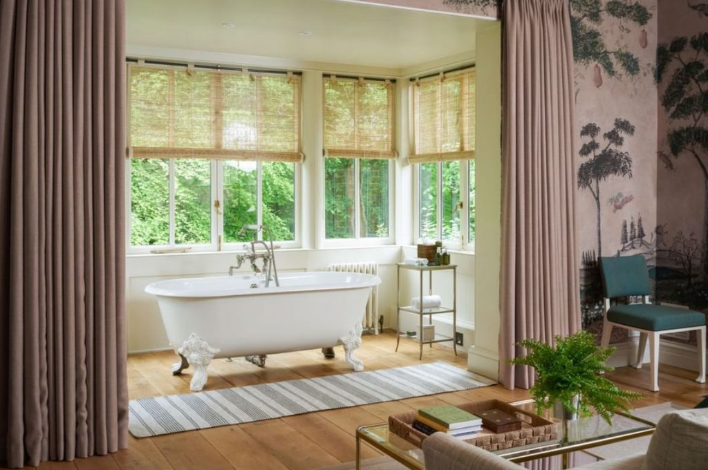 Freestanding bath tub and bamboo blinds at Lime Wood Hotel