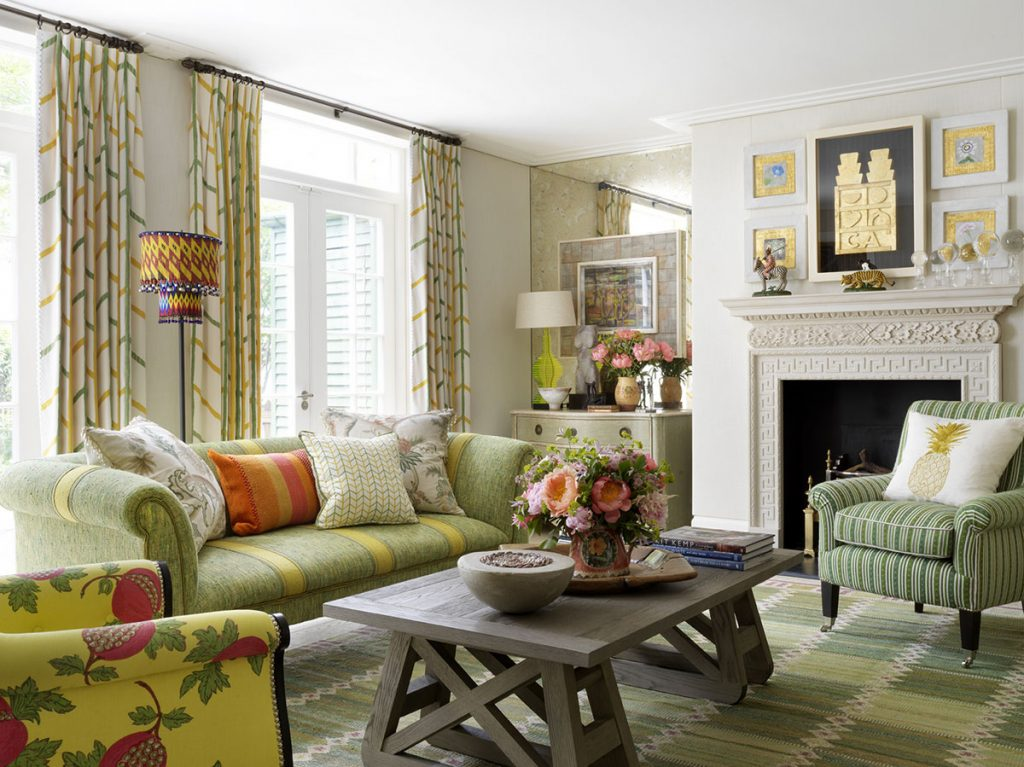 Pattered curtain fabric, white walls and bold fabrics in the living room of London-Mews-house-designed by Kit Kemp