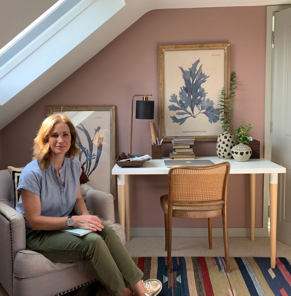 Ros in her home study, home office, desk space, cane chair, Oka decorative pots, Oka wicker desk accessories, Oka framed prints, Oka table lamp, sulking room pink farrow & ball