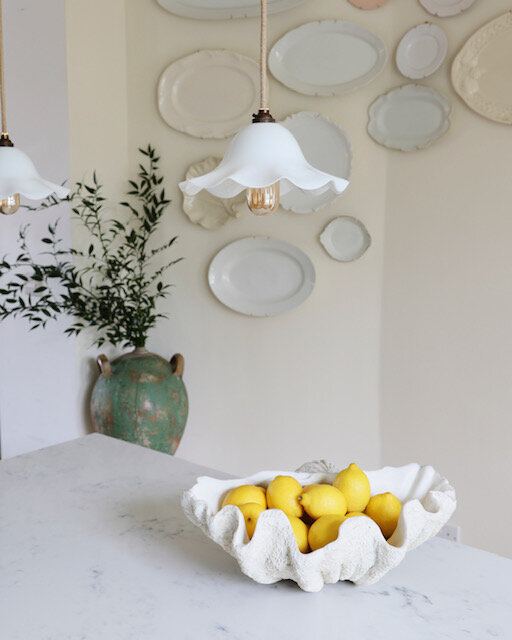 Sophie Rowell interior designer Côte de Folk plate wall antique pendant light Matilda Goad shell with lemons and vase with greenery