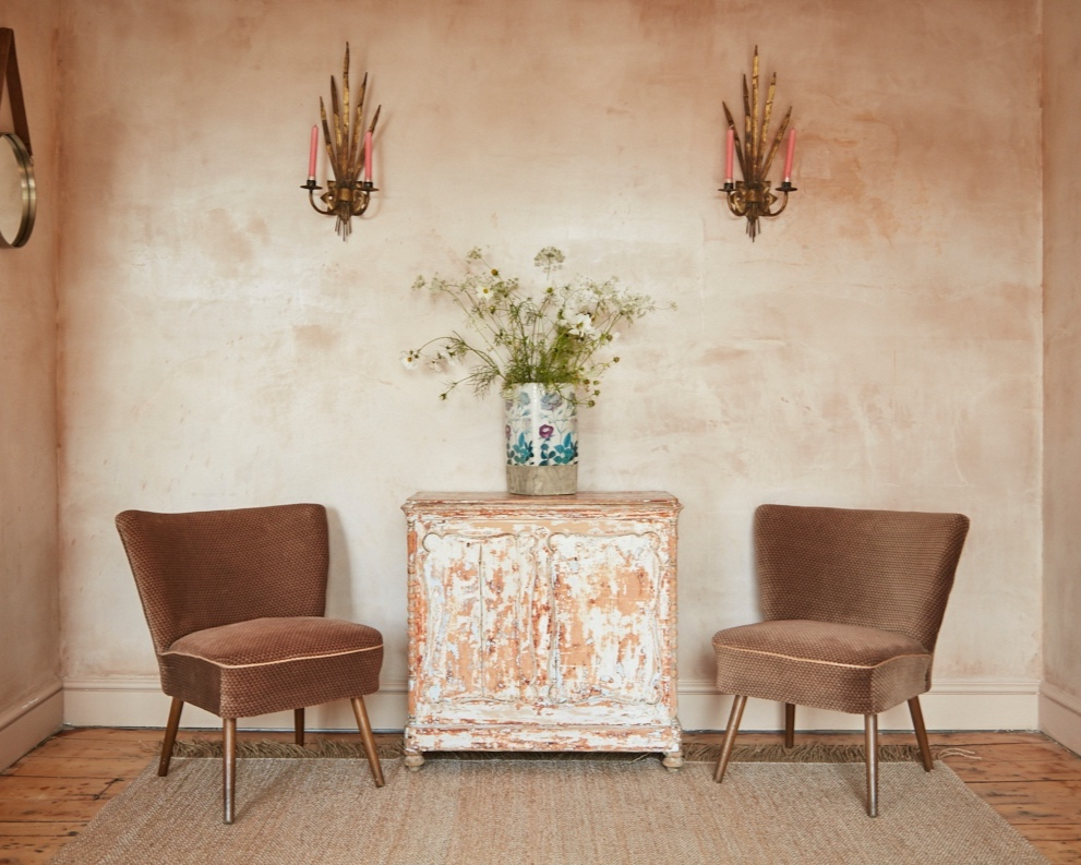 Interior designer Sophie Rowell of Côte de Folk plastered wall, vintage cocktail chairs and antique brass wall sconces