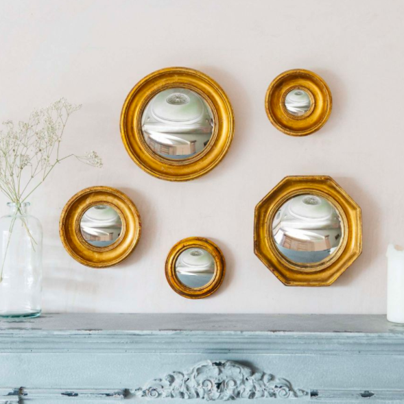 Gold convex wall mirrors, £18 - £37, Graham & Green