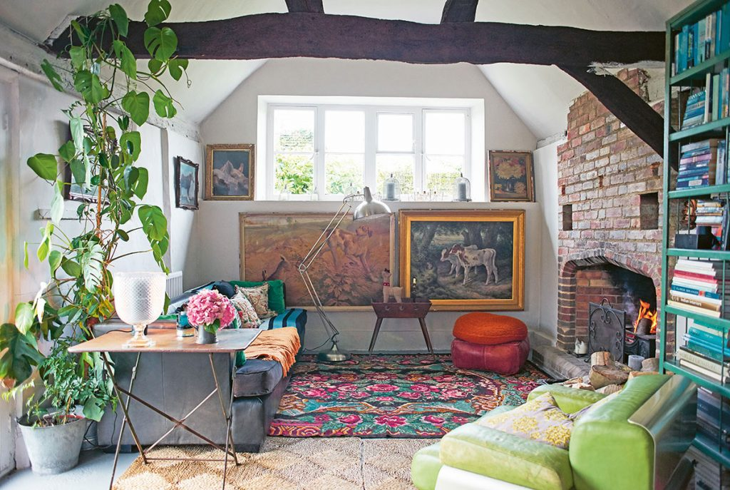 Nikki Tibbles' snug living room with midcentury furniture and vintage bookcase at her home in Petworth, East Sussex. From Cool Dogs, Cool Homes by Geraldine James. Photo: James Gardiner