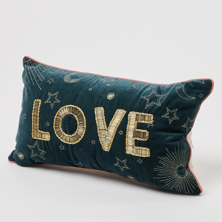 Love beaded blue velvet cushion, £32, Oliver Bonas