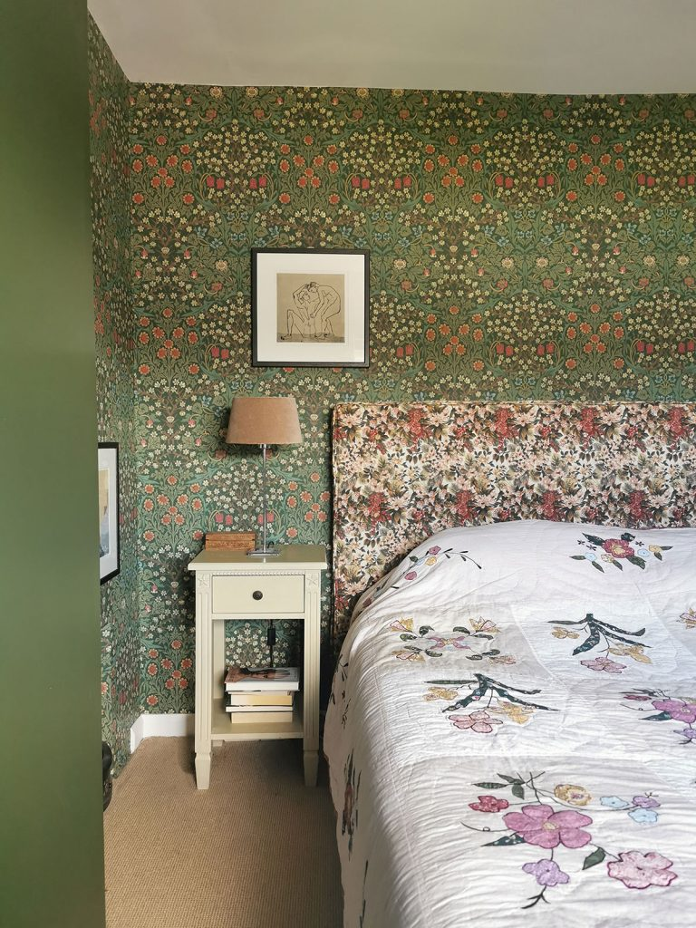 Laura Hunter bedroom with Morris & Co Blackthorn wallpaper and floral headboard