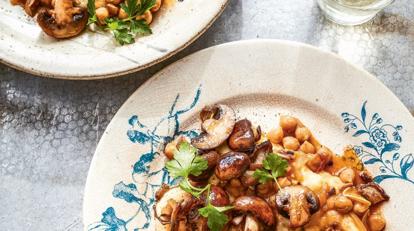 Rich mushroom ragù on parmesan polenta from Rustica by Theo Michaels, photography by Mowie Kay © Ryland, Peters & Small
