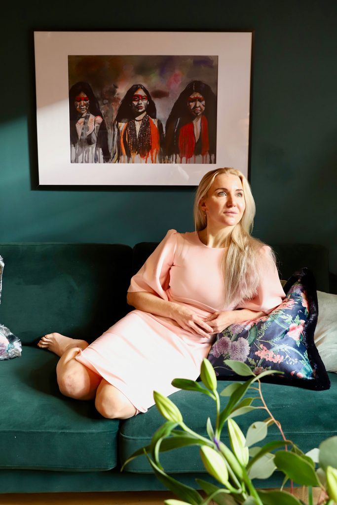 Design Havens for Heroes recipient Dr Claire on green velvetsofa