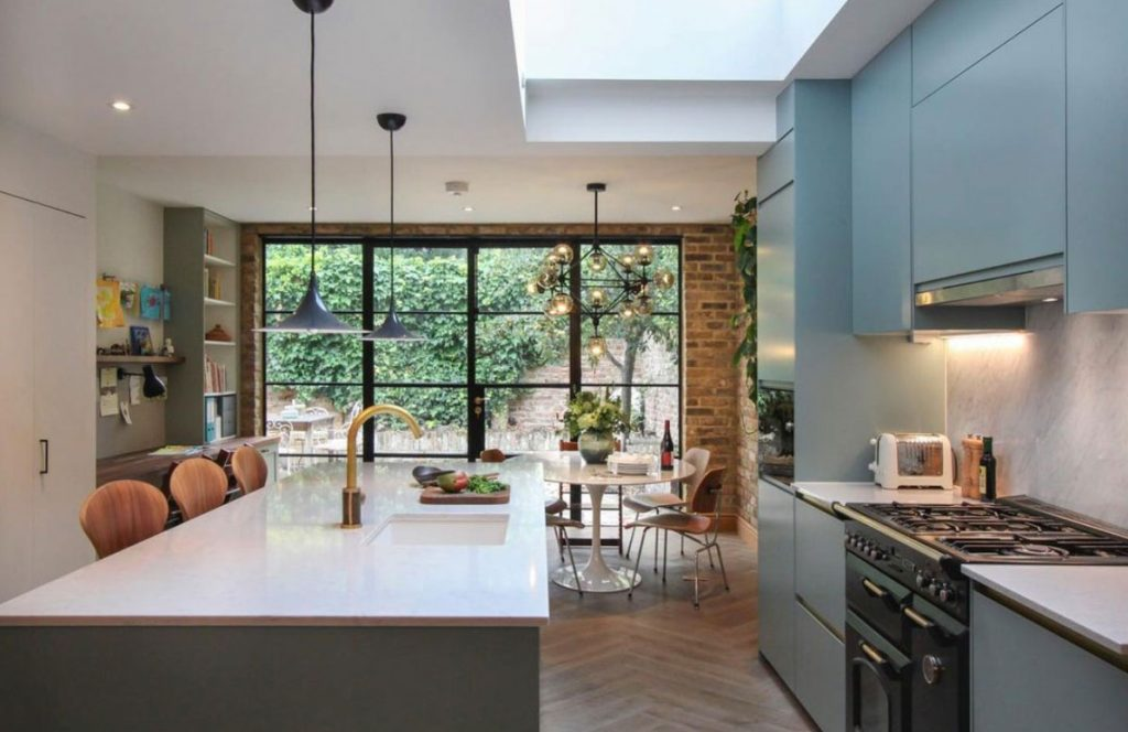 Open plan kitchen diner with crittal windows designed by Yoko Kloeden Design, part of the Design Havens for Heroes initiative