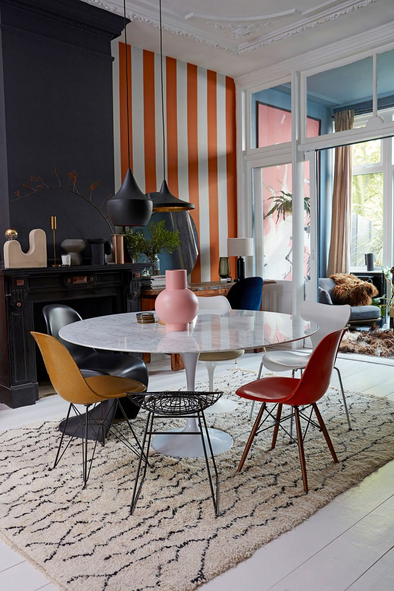 Striped wall, round marble tulip table and scandi decor at the home of interior stylist Theobert Pot from Everything by Abigail Ahern