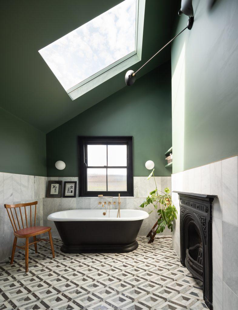 Gemma Ruse bathroom with freestanding rolltop bath, Little Greene green walls and large skylight. Photography by Fraher & Findlay/AdamScott