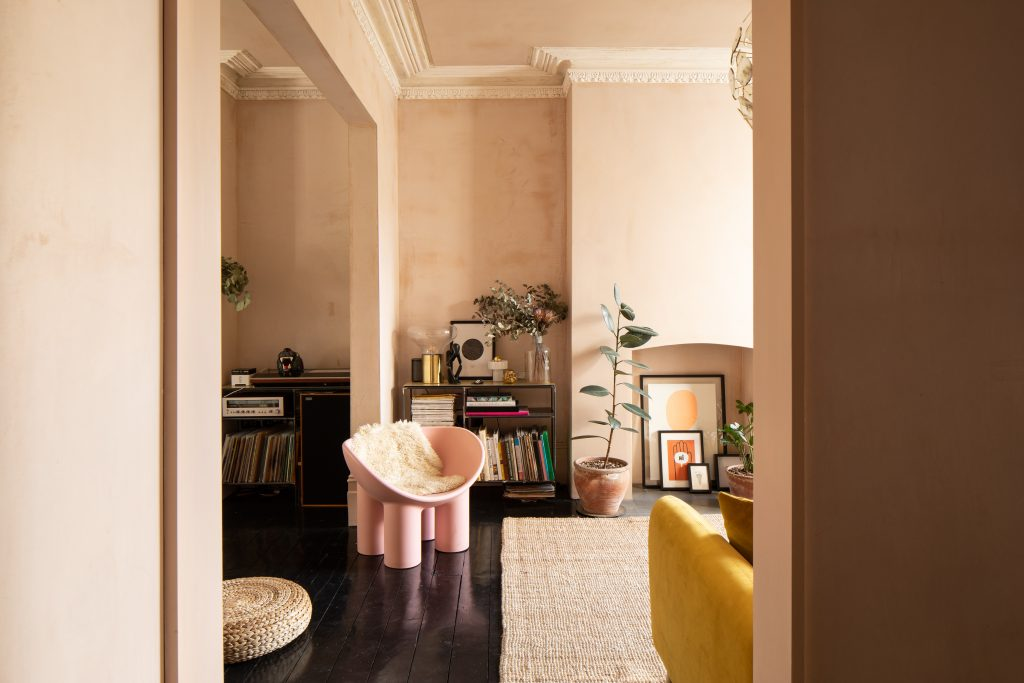 Gemma Ruse TV room with raw plaster walls, original cornicing, pink bucket chair. Photography by Fraher & Findlay/AdamScott