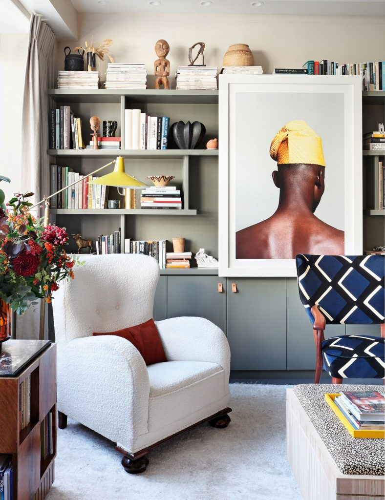Sophie Ashby previous home at Television Centre © Alexander James , styling by Olivia Gregory. Built-in bookshelf, armchair and yellow accents