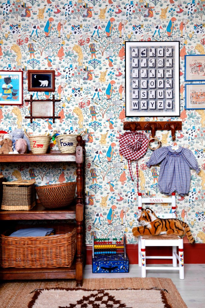 Interior Designer Lonika-Chande's-child's-bedroom with antique storage, toys and House of Hackney wallpaper