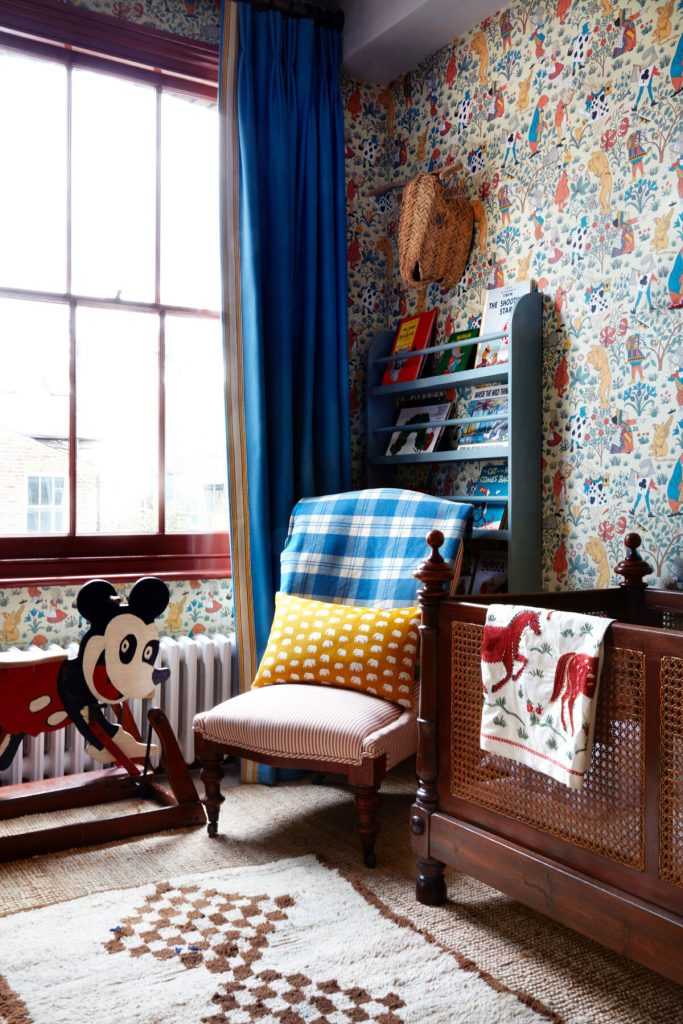 Interior Designer Lonika-Chande's-child's-bedroom with antique cot and chair, toys and House of Hackney wallpaper