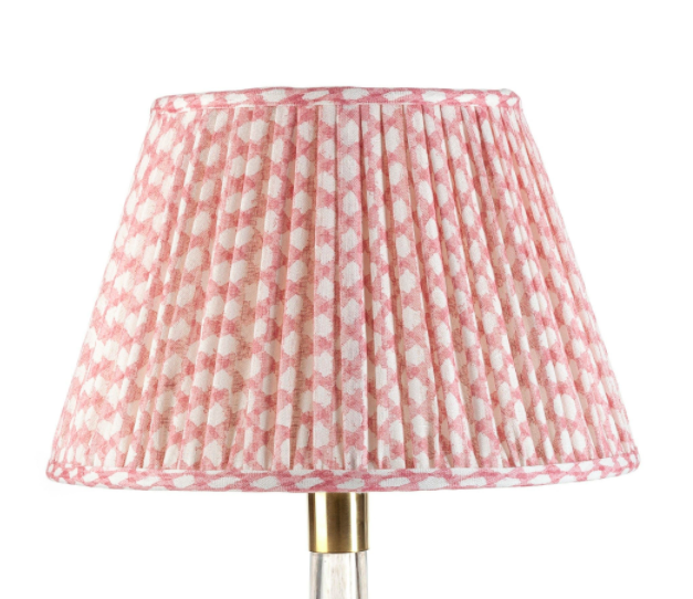 pink wicker fabric gathered lampshade, £220, by Fermoie