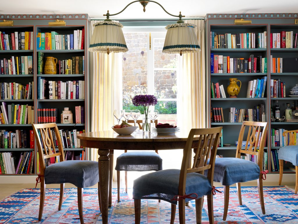 Dining table with bookshelves designed by interior designer Beata Heuman from her book Every Room Should Sing © Rizzoli