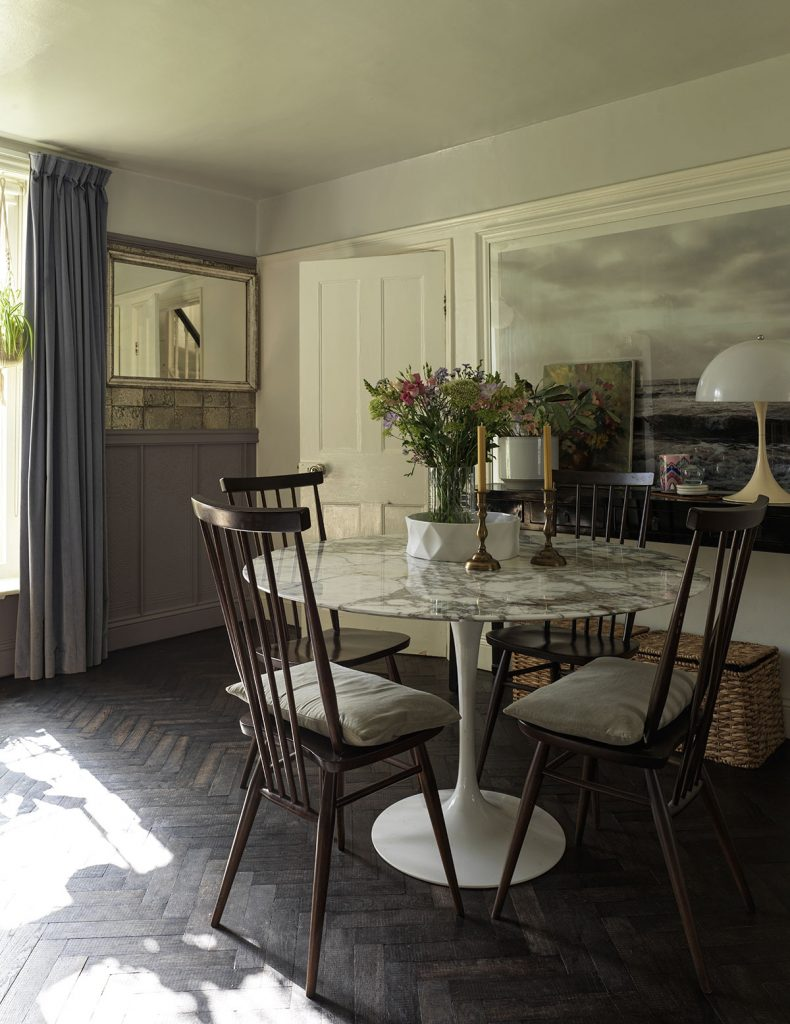 Michelle Ogundehin's dining room at her home in Brighton and marble tulip table and mid-century chairs.Image: Marianna Wahlsten