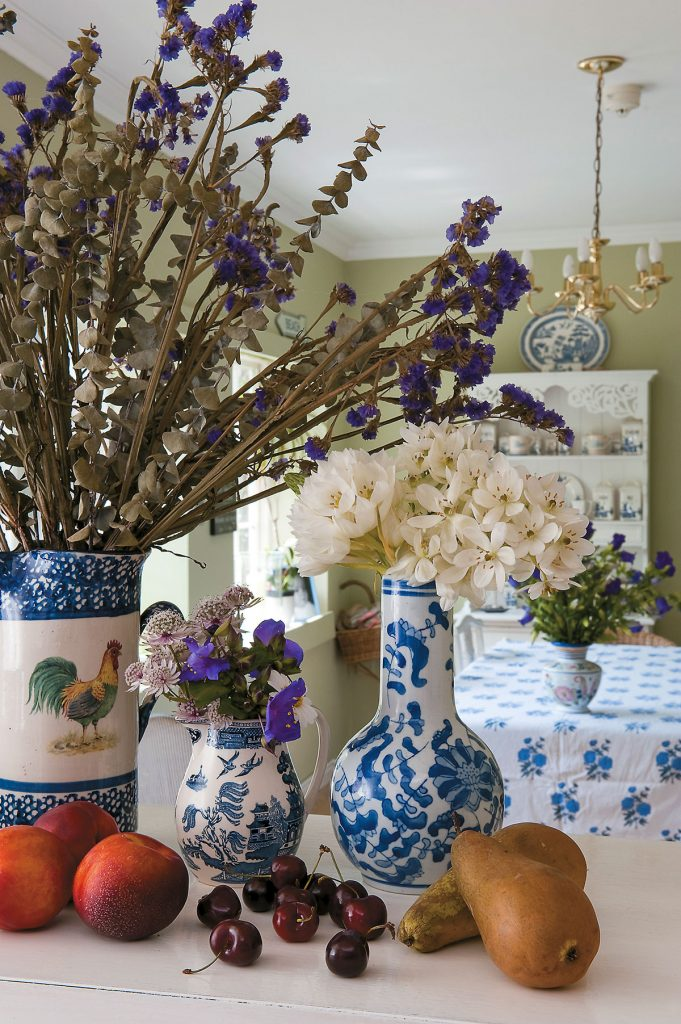 Flowers in the kitchen at Lamb House in Rye, East Sussex. Designed by Francesca Rowan Plowden