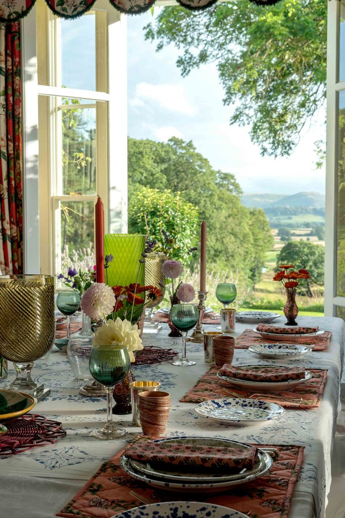 Interior designer Penny Morrison's dining table with view across the Welsh countrside © Mike Garlick Photography