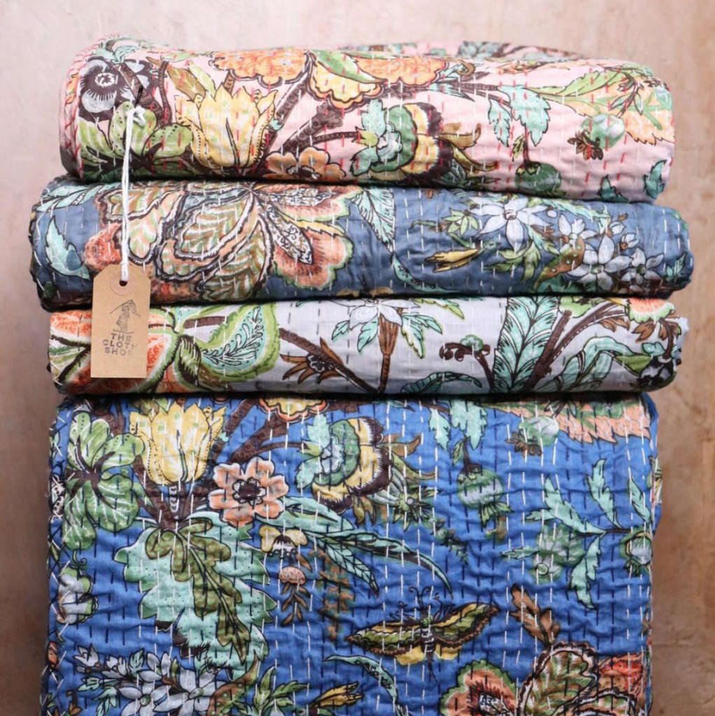 Floral vintage quilts from The Cloth Shop, Portobello Road, London