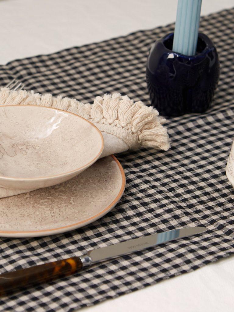Set of four tasselled linen napkins & table runner £245, Matches Fashion