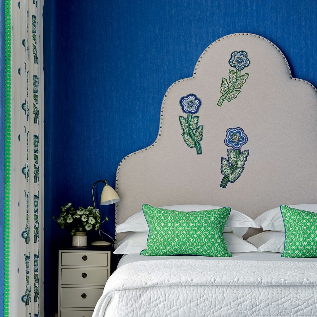 Kit-Kemp-blue-and-green-floral-headboard in blue bedroom. Image: Simon Brown