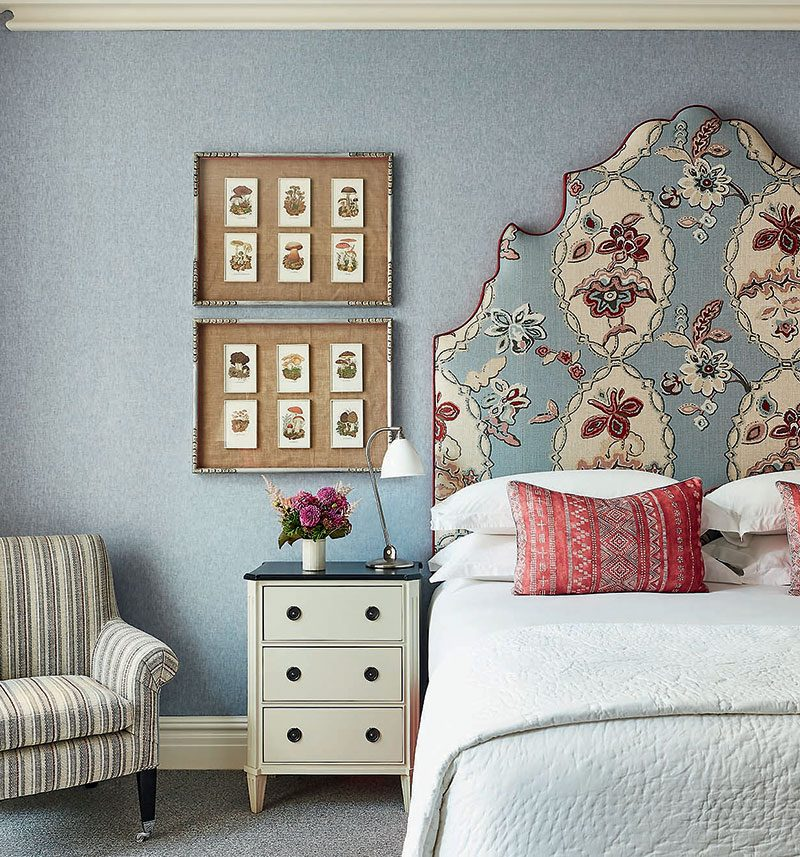 Kit-Kemp-floral-headboard-in-blue-bedroom-at the Whitby Suite. Image: Simon Brown