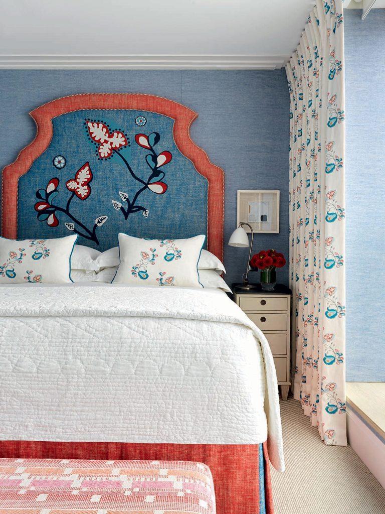 Kit-Kemp-blue and orange floral headboard-in-blue-bedroom. Image: Simon Brown