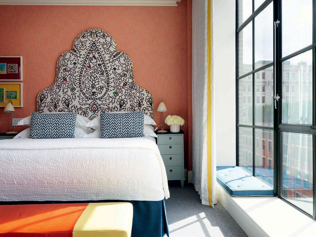 Kit-Kemp-headboard-in-orange-bedroom. Image: Simon Brown