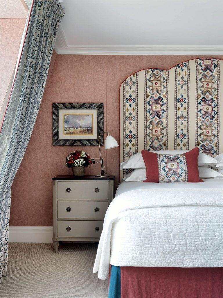 Kit-Kemp-patterned headboard-in-pink-bedroom. Image: Simon Brown