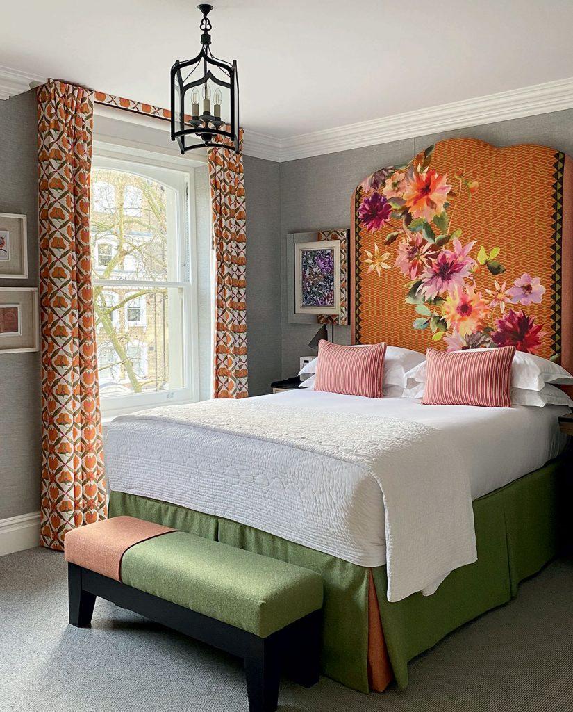 Kit-Kemp-orange-headboard in bedroom at the Knightsbridge Hotel in London. Image: Simon Brown