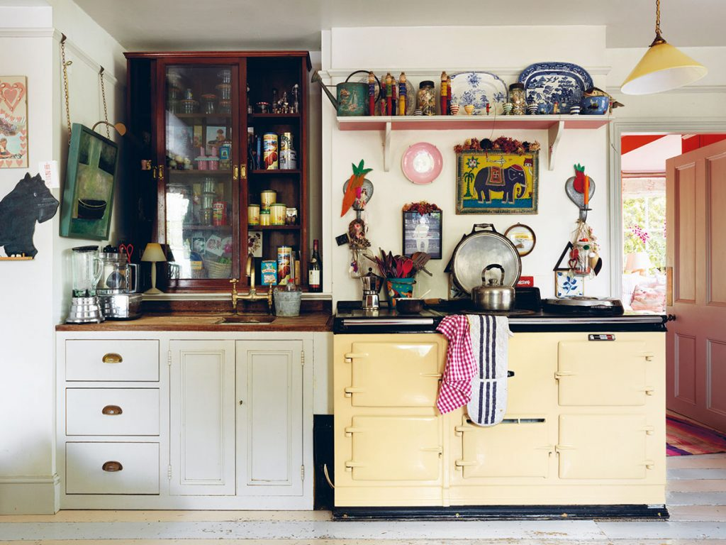 Eclectic and colourful English country style kitchen. Image by Simon Brown