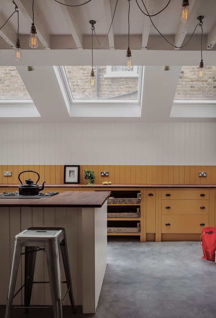 Tongue and groove kitchen backsplash in India Yellow and Pointing by Farrow and Ball. Cabinets by British Standard