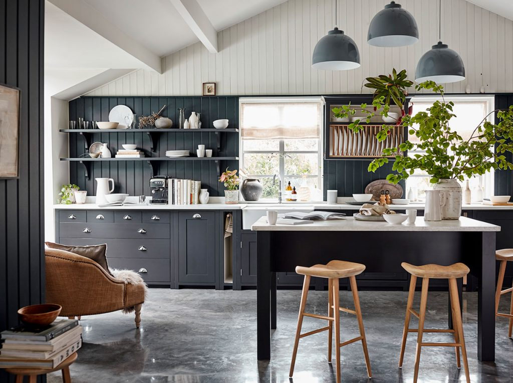 Tongue and groove panelling in inky blue and white in kitchen by Neptune