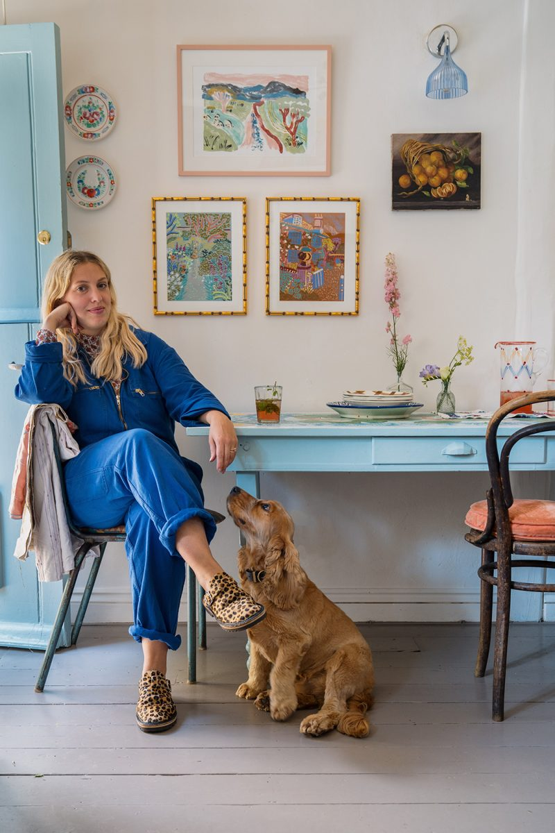 Artist Camilla Perkins at home in her studio with her dog